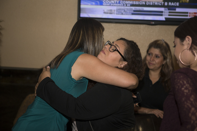 Democratic Congressional District 4 candidate Lucy Flores, left, hugs her niece Vivian Flores after giving her concession speech during her election night party at Aces & Ales on Tuesday, June ...