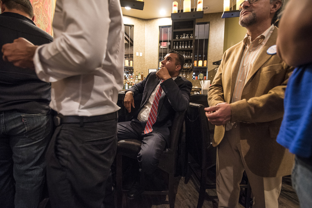 Democratic Congressional District 3 candidate Jesse Sbaih, center, watches the news for results during a campaign event at Origin India Restaurant in Las Vegas on Tuesday, June 14, 2016. Joshua Da ...