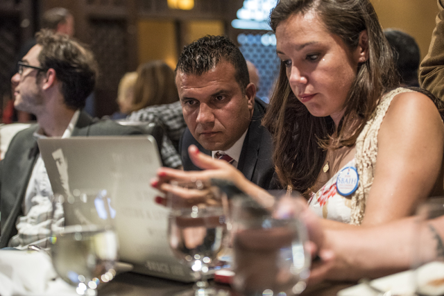 Democratic Congressional District 3 candidate Jesse Sbaih, left, and Angie Morelli, Sbaih's campaign manager, look at election results during a campaign event at Origin India Restaurant in Las Veg ...