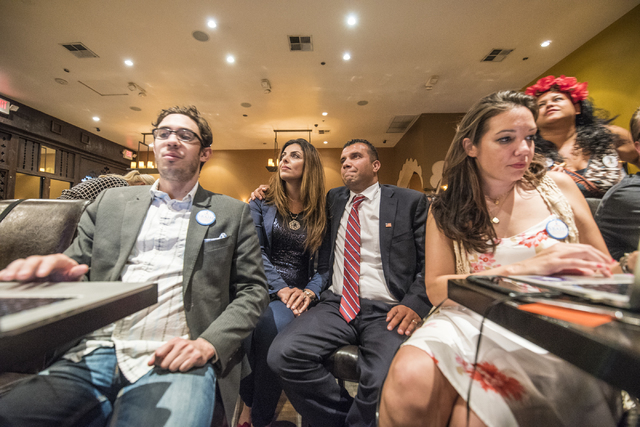 Steven Conger Jr., assistant campaign manager, from left, Sameera Sbaih, Democratic Congressional District 3 candidate Jesse Sbaih, and campaign manager Angie Morelli look at election results duri ...