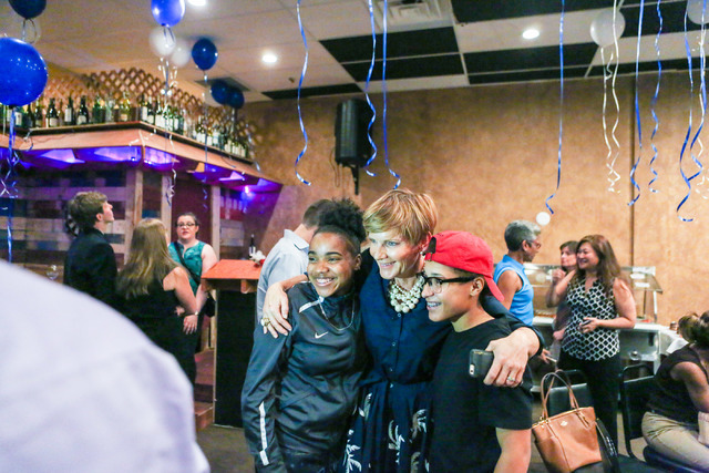 Democratic Congressional District 4 candidate Susie Lee gets a photo taken with her high school interns after losing  primary elections during her election watch party at Saffron Flavors of India  ...