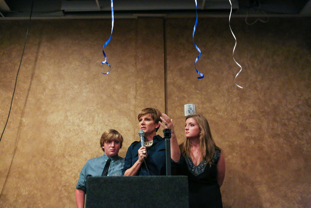Democratic Congressional District 4 candidate Susie Lee shares a story of door to door campaigning tearfully with her son Cody Lee, left, and daughter Nevada Lee, right, after losing primary elect ...