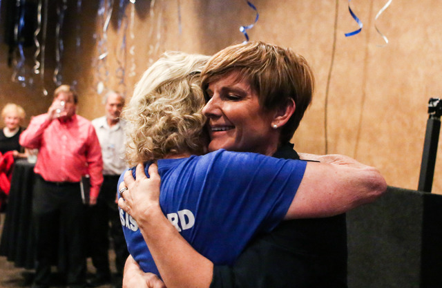 Democratic Congressional District 4 candidate Susie Lee gets consoled by her friend after losing primary elections during her election watch party at Saffron Flavors of India in Las Vegas Tuesday  ...