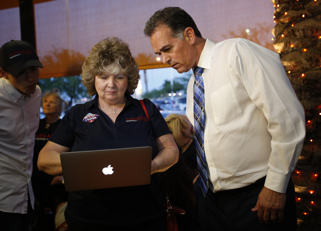 Republican Congressional District 3 candidate Danny Tarkanian, left, looks at campaign results with campaign assistant Judy Flynn during his election night gathering at Born and Raised in Las Vega ...