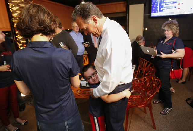 Republican Congressional District 3 candidate Danny Tarkanian hugs his son Jerry, 6, during his election night gathering at Born and Raised in Las Vegas on Tuesday, June 14, 2016. (Richard Brian/L ...