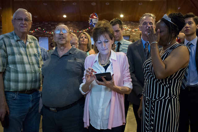 Laurel Fee, a political consultant for Nevada Assemblyman Brent Jones, checks her phone during a watch party at Old School Brewing Company in Las Vegas on June 14, 2016. (Bridget Bennett/Las Vegas ...