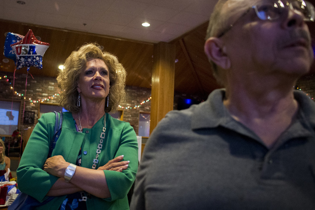 Nevada Republican National Committeewoman and Assembly candidate Diana Orrock watches results come in during a watch party at Old School Brewing Company in Las Vegas on June 14, 2016. (Bridget Ben ...