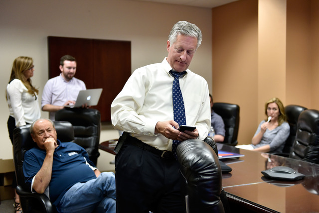 Nevada Assemblyman Keith Pickard checks the election returns on his mobile device during a watch party at Paul Anderson's office Tuesday, June 14, 2016, in Las Vegas. David Becker/Las Vegas Review ...