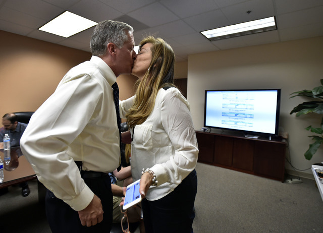 Keith Pickard, left, receives a kiss from his wife, Margaret Pickard, during an election watch party at Paul Anderson's office Tuesday, June 14, 2016, in Las Vegas. David Becker/Las Vegas Review-J ...