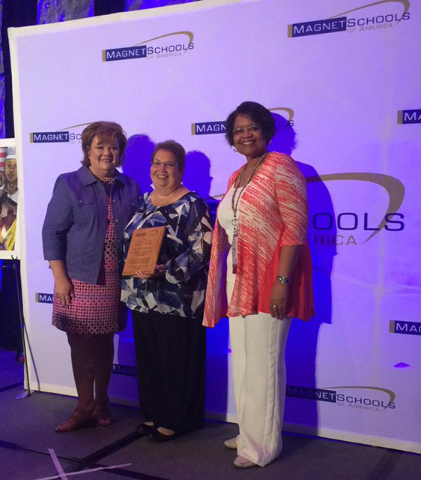 In early May 2016, Sandy Searles Miller Academy for International Studies principal Dr. Anne Grisham, center, was presented the Regional Principal of the Year Award by Magnet Schools of America. S ...