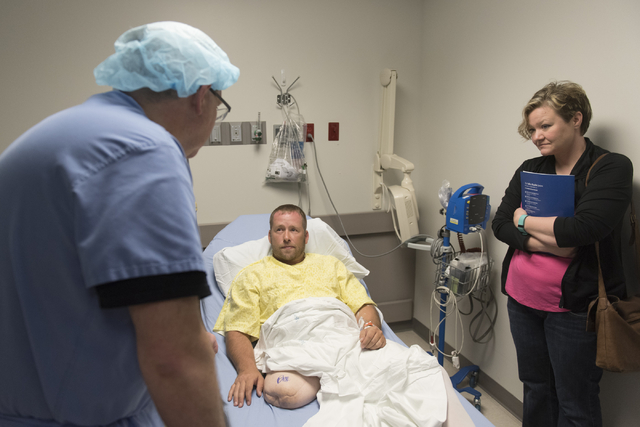 Dr. Ronald Hillock, left, patient, Anthony Reff, center, and his wife, Tina, prepare for Anthony's osseointegration surgery at Centennial Hills Hospital in Las Vegas Friday, June 3, 2016. The Reff ...