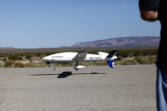 Sandstorm, an experimental unmanned aircraft system manufactured by Unmanned Systems, Inc., is piloted in for a landing by Michael Toland of National Security Technologies at the Desert Rock Airpo ...