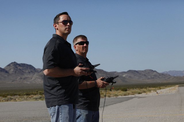 UAS pilots Michael Toland and Dave Carder of National Security Technologies practice flying fixed wing UAVs at Desert Rock Airport at the Nevada National Security Site on Monday, June 13, 2016. (M ...