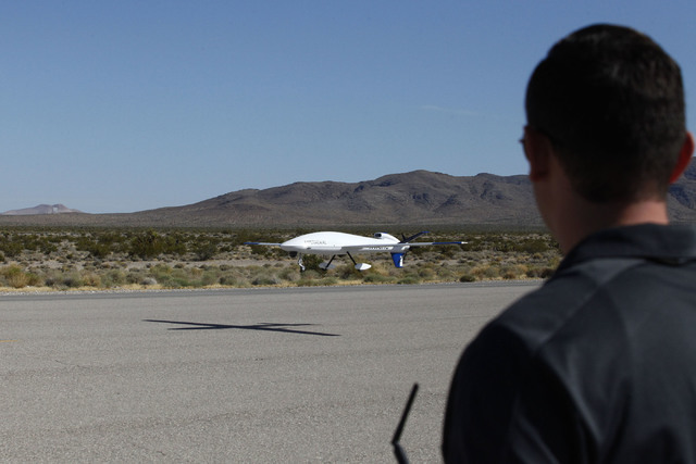 Sandstorm, an experimental unmanned aircraft system manufactured by Unmanned Systems, Inc., is piloted in for a landing by Michael Toland of National Securities Technologies at the Desert Rock Air ...