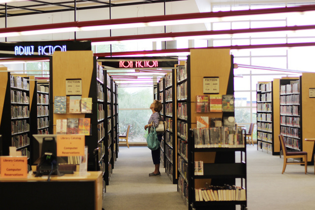 Connie Wilson of Las Vegas scans the bookshelves at the Rainbow branch of the Las Vegas-Clark County Library district on June 18, 2016. (Adelaide Chen/Las Vegas Review-Journal)