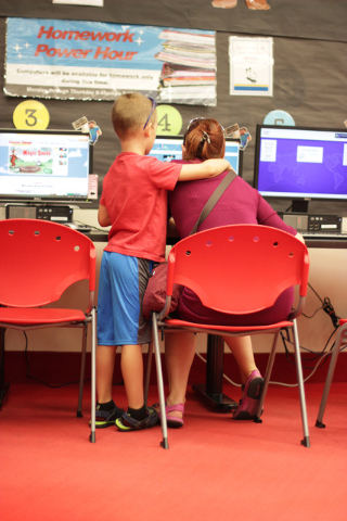 A child shares a moment with his mother while playing on the computers at the Rainbow branch library of the Las Vegas-Clark County Library District on June 18, 2016. (Adelaide Chen/Las Vegas-Revie ...