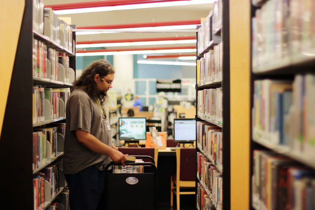 Mark Diaz, a library page, shelves books at the Rainbow branch of the Las Vegas-Clark County Library District on June 18, 2016.  (Adelaide Chen/Las Vegas Review-Journal)