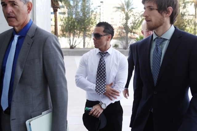 Ernesto Joshua Ramos, center, walks to Lloyd George U.S. Courthouse in Las Vegas to plead guilty to an extortion charge Tuesday, Nov. 3, 2015. Erik Verduzco/Las Vegas Review-Journal Follow @Erik_V ...