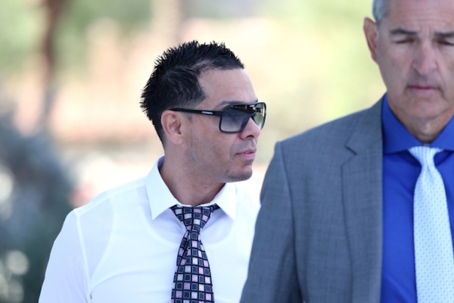 Ernesto Ramos, left, walks to the Lloyd George U.S. Courthouse in Las Vegas with his attorney Gabriel Grasso to plead guilty to an extortion charge Tuesday, Nov. 3, 2015. (Erik Verduzco/Las Vegas  ...