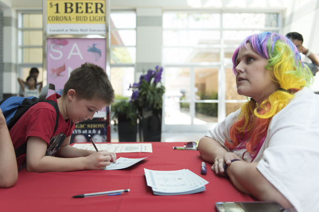Anthony Schattilly, 7, fills out a tally sheet to track completed activities during the Clark County School District's Reading Rangers program kick off at the Boulevard Mall in Las Vegas Saturday, ...