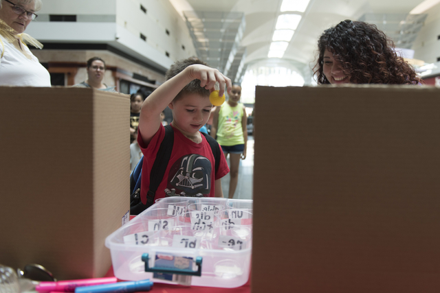 Anthony Schattilly, 7, drops a ball into a cup during the Clark County School District's Reading Rangers program kick off at the Boulevard Mall in Las Vegas Saturday, June 11, 2016. Jason Ogulnik/ ...