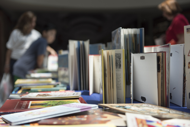 A table with books that are given away as prizes for completing activities during the Clark County School District's Reading Rangers program kick off at the Boulevard Mall in Las Vegas is seen Sat ...