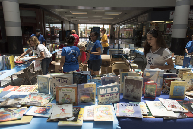 Tables with books that are given away as prizes for completing activities during the Clark County School District's Reading Rangers program kick off at the Boulevard Mall in Las Vegas Saturday, Ju ...