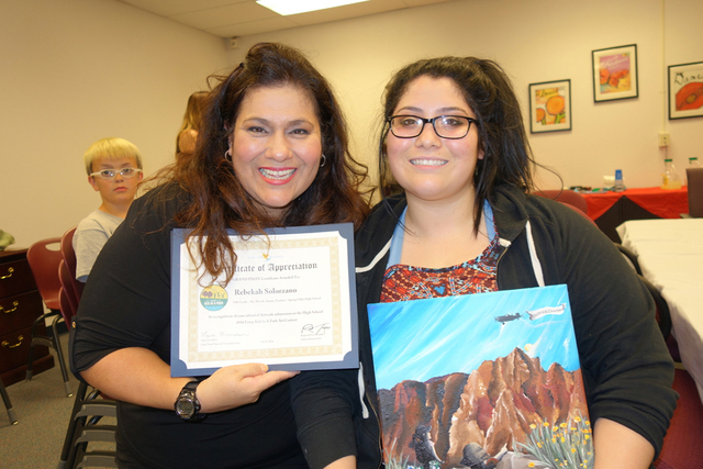 Grand prize winner Rebekah Solorzano, right, smiles with her mother, Jasmine Solorzano, at the reception honoring prize winners for the Every Kid in a Park art contest. Diane Taylor/Special to View
