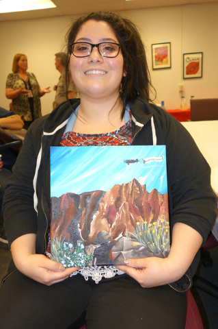 Rebekah Solorzano of Chaparral High School holds her acrylic painting that won the grand prize in the Every Kid in a Park art contest. Diane Taylor/Special to View