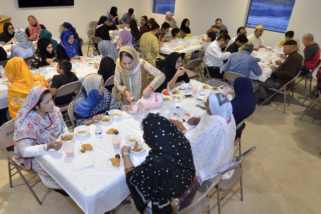 Members of the congregation at Masjid Ibrahim are shown during the evening meal marking the end of the day's fast during Ramadan. (Bill Hughes/Las Vegas Review-Journal)
