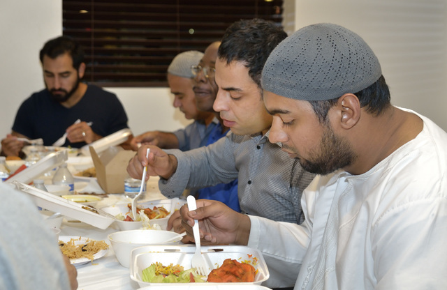 Masroor Ahmed, right, and Rafiullah Jebran eat during the meal marking the end of the day fast for Ramadan at Masjid Ibrahim in Las Vegas. (Bill Hughes/Las Vegas Review-Journal)