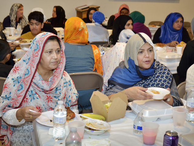 Latifa Bedum, left, and Shirin Rahman are shown during the evening meal marking the end of the day's fast during Ramadan at Masjid Ibrahim. (Bill Hughes/Las Vegas Review-Journal)