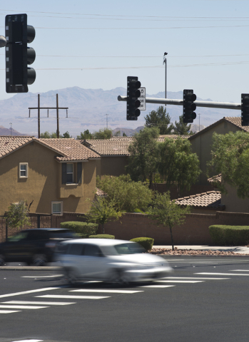 Cars pass through the intersection with new thermal imaging cameras at Gibson Road and Paseo Verde Parkway in Henderson on Thursday, June 16, 2016. Daniel Clark/Las Vegas Review-Journal Follow @Da ...