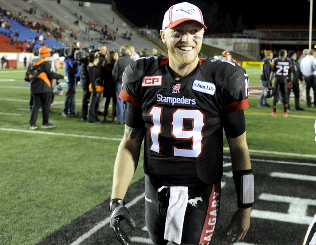 Calgary Stampeders' quarterback Bo Levi Mitchell smiles as he leaves the field after a victory over the BC Lions in the CFL western semi-final football game in Calgary, Alberta, November 15, 2015. ...