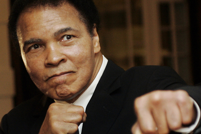 U.S. boxing great Muhammad Ali poses during the Crystal Award ceremony at the World Economic Forum (WEF) in Davos, Switzerland January 28, 2006. (REUTERS/Andreas Meier)