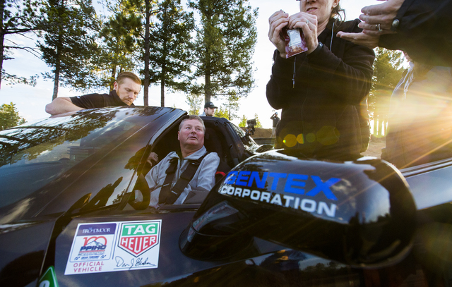 Sam Schmidt, middle, an ex-IndyCar driver paralyzed in a January, 2000 crash, prepares to test his customized Corvette in preparation for the Pikes Peak Hill Climb on Friday, June 10, 2016, in Col ...