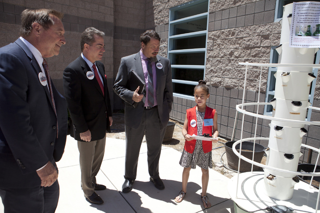 Las Vegas Convention and Visitors Authority President and CEO Rossi Ralenkotter, from left, UNLV President Len Jessup and Clark County School District Superintendent Pat Skorkowsky get a tour from ...