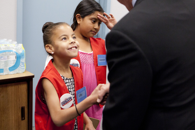 Lilly Hale, left, and Stephanie Melendez shake hands with UNLV president Len Jessup after a tour of Paradise Elementary School on UNLV's Campus on Wednesday, June 15, 2016. (Loren Townsley/Las Veg ...