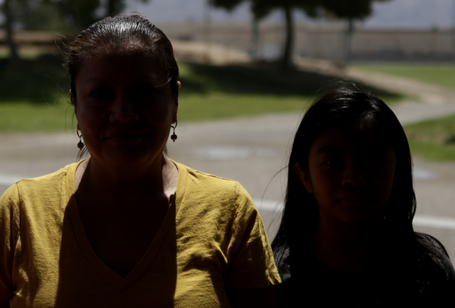 Francisca Sanchez, 41, left, and her daughter Karla Ortiz, 11, who don't want to show their face, are photographed during an interview at Nellis Meadows Park on Thursday, June 9, 2016, in Las Vega ...