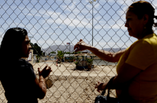 Francisca Sanchez, 41, right, and her daughter Karla Ortiz, 11, who don't want to show their face, pose for a photo during at Nellis Meadows Park on Thursday, June 9, 2016, in Las Vegas. (Bizuayeh ...