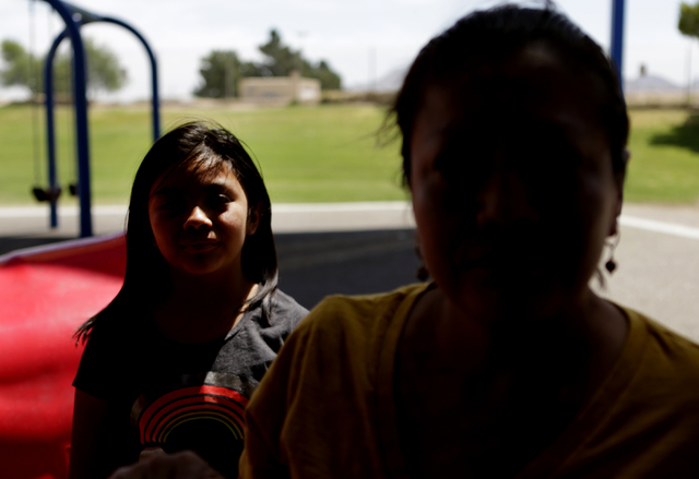 Francisca Sanchez, 41, who doesn't want to show her face, right, and her daughter Karla Ortiz, 11, pose for a photo at Nellis Meadows Park on Thursday, June 9, 2016, in Las Vegas. (Bizuayehu Tesfa ...