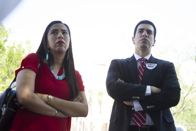 Immigration attorney Jocelyn Cortez, left, and Democratic nominee for the 4th Congressional District Ruben Kihuen, attend a press conference on the Supreme Court's tie vote that blocks the Deferre ...