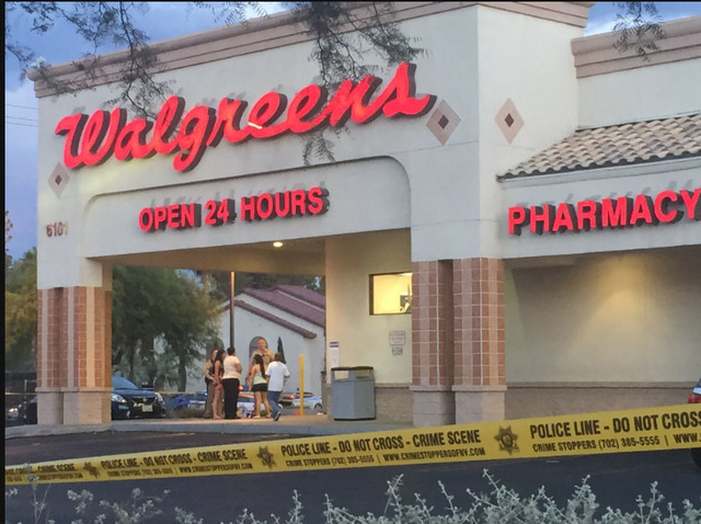 Las Vegas police investigate a homicide outside of a Walgreens at Lake Mead and Jones Boulevards in Las Vegas on Wednesday, June 29, 2016. (Rachel Crosby/Las Vegas Review-Journal)