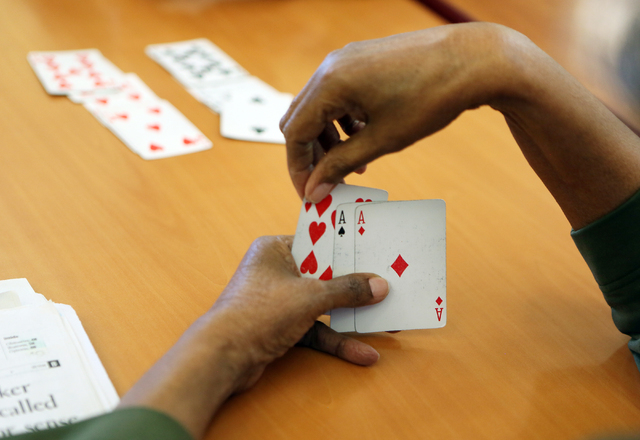 A woman plays cards with friends at Nevada Senior Services' Adult Day Care Center Wednesday, June 1, 2016, in Las Vegas. (Ronda Churchill/Las Vegas Review-Journal)