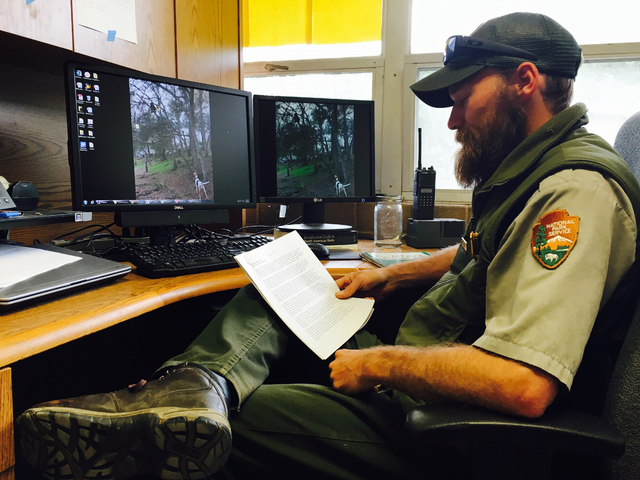 Park Biologist Danny Gammons sits in his office at the Sequoia National Park in California, reviewing the file of bear L-13, which was destroyed in 2015 after it began raiding campsites and cabins ...