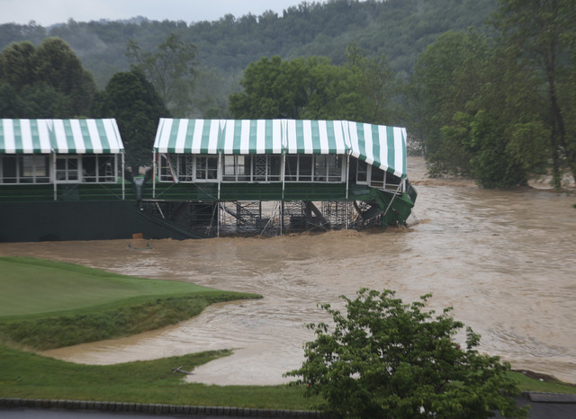 This Thursday June 23, 2016 image provided by the Greenbrier shows flooding on the 18th green of the Old White Course at the Greenbrier in White Sulphur Springs, W.Va. (Cam Huffman/The Greenbrier  ...