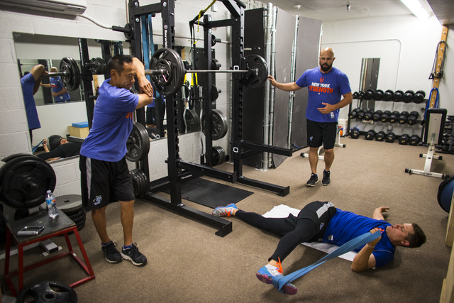 Las Vegas 51s player Paul Sewald, center, talks with strength and conditioning coach Jon Cioffi, left, and Nevin Ashley, right while working out ahead of a game against the El Paso Chihuahuas at C ...
