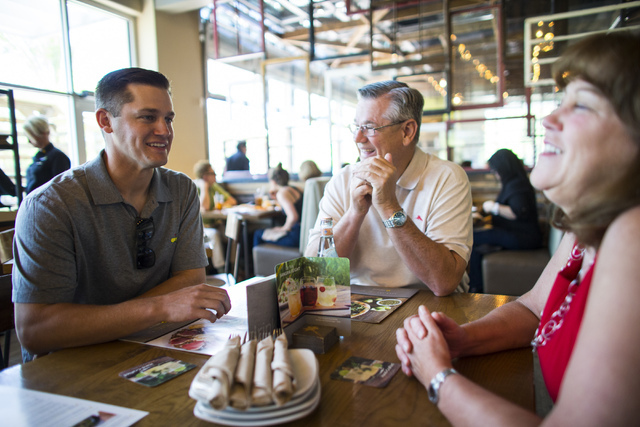 Las Vegas 51s player Paul Sewald, left, eats out for lunch with his parents Mark and Judi at Downtown Summerlin in Las Vegas on Friday, May 13, 2016. Sewald, a Las Vegas native, has been living wi ...