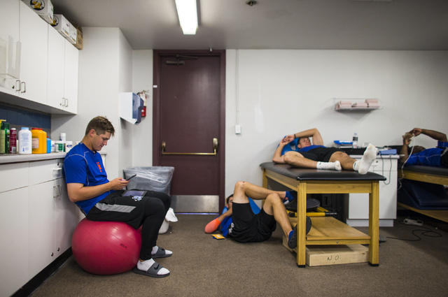 Las Vegas 51s player Paul Sewald, left, plays the USA Today crossword puzzle on his iPad in the clubhouse ahead of a game against the El Paso Chihuahuas at Cashman Field in Las Vegas on Friday, Ma ...