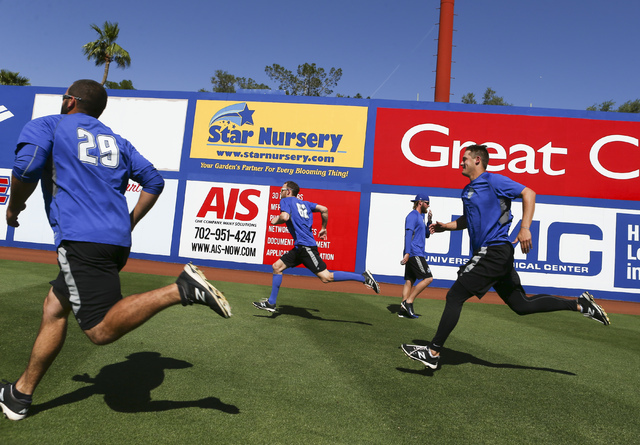 Las Vegas 51s players, from left, Chasen Bradford, Erik Goeddel, Jeff Walters and Paul Seward warm up ahead of a game against the El Paso Chihuahuas in Las Vegas on Friday, May 13, 2016. (Chase St ...